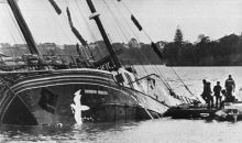 The Rainbow Warrior, part submerged in Auckland harbour