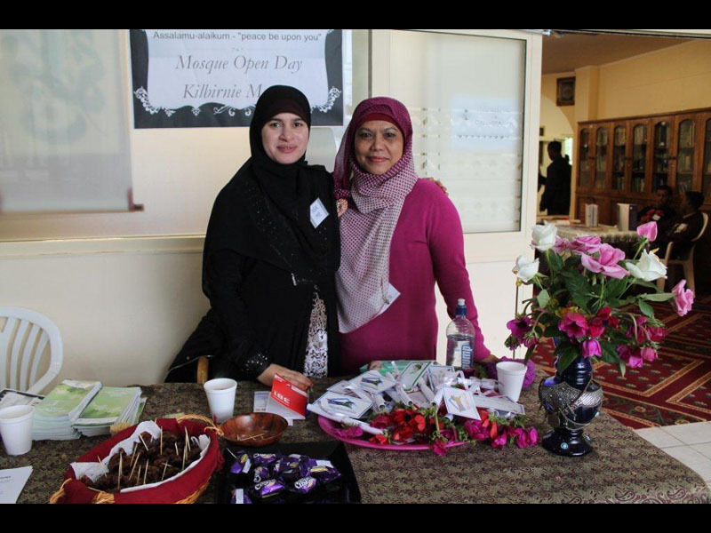 Full asma and her friend welcome at the entrance  open day