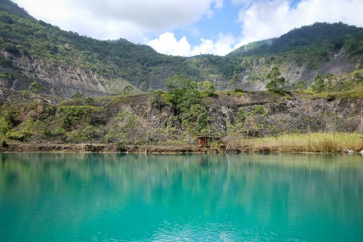 Full a lake in the pit of the long defunct panguna mine in bougainville.