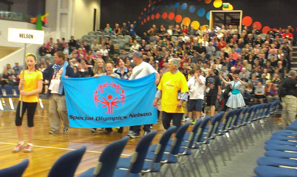 Full the special olympics team from nelson enters the arena during the closing ceremony