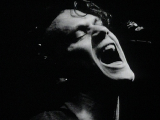 A black and white still shot of Shayne Carter from the 1992 music video for the single, 'Done'.