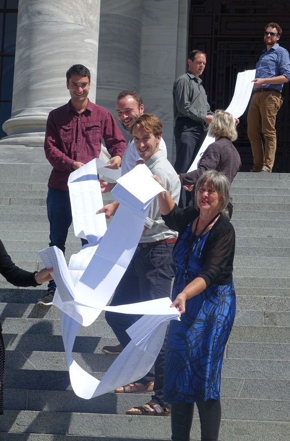 Catherine Delahunty (front) holding part of the list of 12,000 names supporting the call for swimmable freshwater.