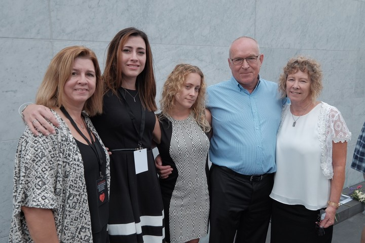 Right to left: Bruce, Jeanette and Sarah McEachen, the parents and sister of Matthew McEachen, stand with Lauren and Deb Conley, the stepsister and stepmother of Rachel Conley.