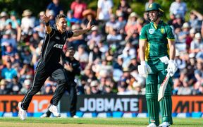 Trent Boult of the Black Caps gets the wicket of AB de Villiers of South Africa during the second One Day International Cricket match.