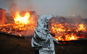 Campers set structures on fire in preparation of the Army Corp's 2pm deadline to leave the Oceti Sakowin protest camp.