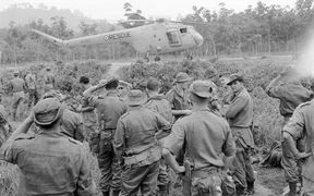 New Zealand SAS soldiers with a Bristol Sycamore helicopter of the Royal Air Force, in a photograph taken by a NZ Army photographer during the Malayan Emergency.