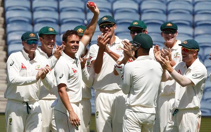 Australian spinner Steve O'Keefe celebrates taking a wicket with team-mates.