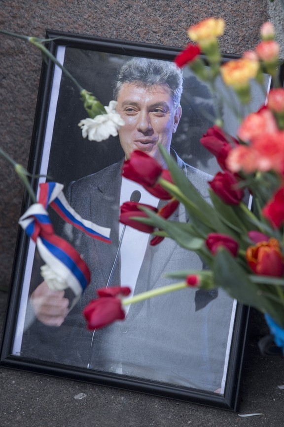 Flowers are placed at the ceremony marking  Boris Nemtsov's death.