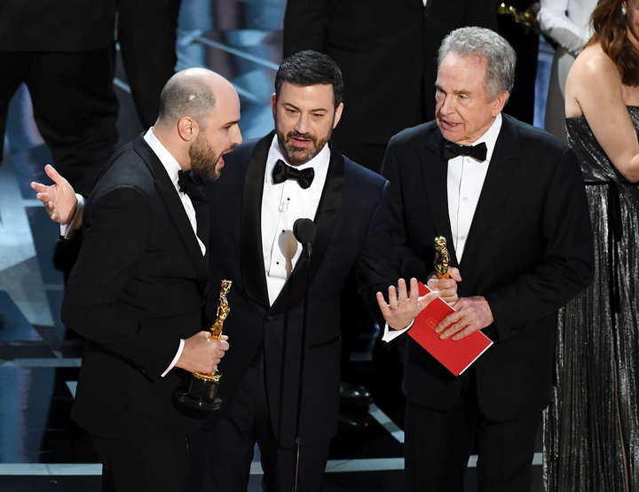 La La Land' producer Jordan Horowitz (left) announces actual Best Picture winner as 'Moonlight' after a presentation error with host Jimmy Kimmel and actor Warren Beatty onstage.