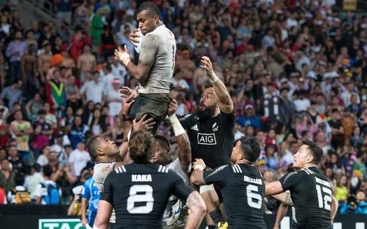 Apisai Domolailai jumps for the ball against New Zealand.