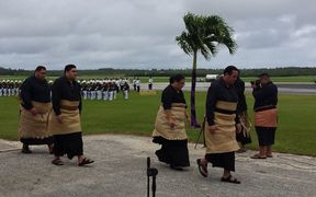 Tonga's Crown Prince Tupouto'a 'Ulukalala, (right), leads members of the royal family to welcome the body of Queen Mother Mata'aho home