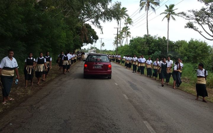 Students prepare to welcome the late Queen Mother Halaevalu Mata'aho