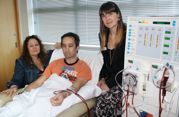 Dialysis education nurses Sandy Neale (L) and Becky Hayston with patient Kori Solomon.