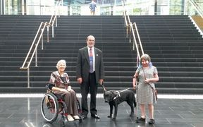 (From left) Vivian Naylor of CCS Disability Action, Chris Orr of the Blind Foundation and Esther Woodbury of Disabled Persons Assembly NZ, inside the Spark Building on Victoria Street West in central Auckland.