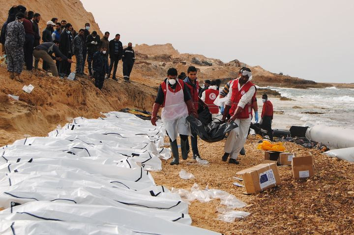 February 21, 2017 by the Al-Zawiyah Branch of the Libyan Red Crescent shows Libyan Red Crescent volunteers recovering the bodies of 74 migrants that washed ashore on February 20 near Zawiyah on Libya's northern coast.