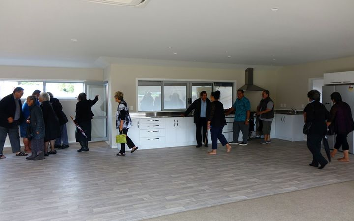 The kitchen and living area is inspected after the house was blessed.