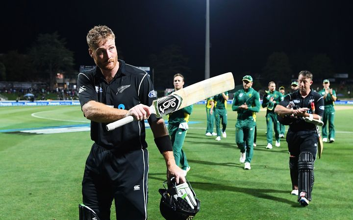 Martin Guptill walks off Seddon Park after scoring an unbeaten 180 and beating South Africa.