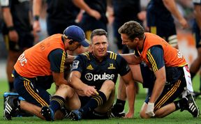 Ben Smith gets medical attention during the Highlanders match against the Chiefs.