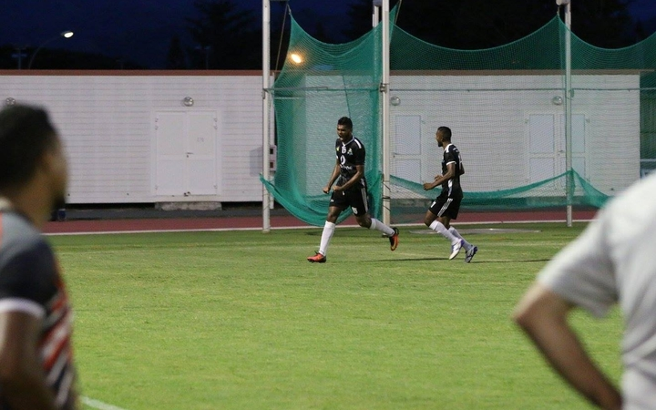 Ba celebrate the winning goal as Puaikura FC look on.