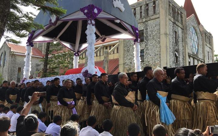 A procession carrying the body of Tonga's late Queen Mother Halaevalu Mata'aho, marches through the capital, Nuku'alofa.