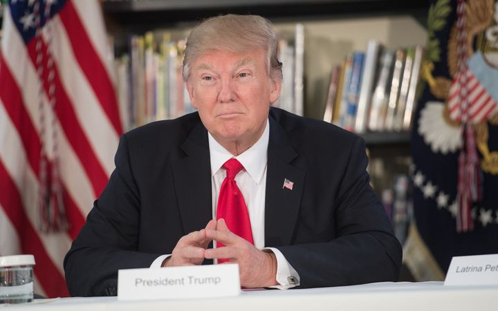 US President Donald Trump meets with parents and teachers at Saint Andrew Catholic School in Orlando, Florida.