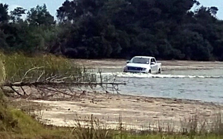 A 4WD being washed in the lake Waiporohita.