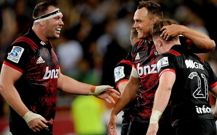 Israel Dagg (r) celebrates with Owen Franks of the Crusaders following their win over the Highlanders.