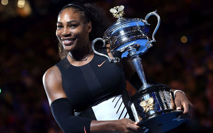 Serena Williams with the Australian Open trophy.