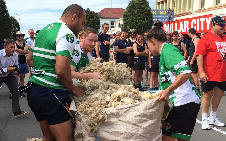 The Turbo Rugby Team stuffing their wool fadge.