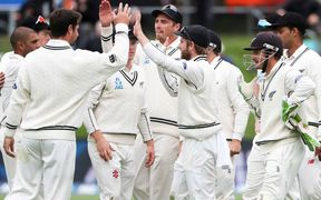 The Black Caps celebrate Kane Williamson's a catch to dismiss Dean Elgar.