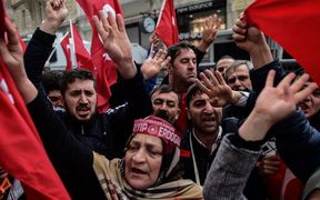 Protesters shout slogans and wave Turkish national flags in front of the Dutch Consulate in Istanbul.
