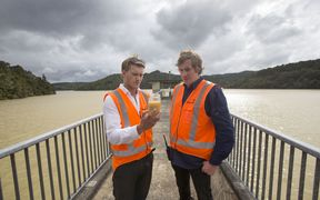 Operations controller James Talbot and headworks manager Joseph Chaloner Warman take samples at Cosseys Dam.