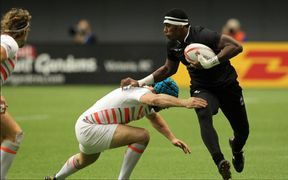 Fiji's Kalione Nasoko tries to beat the England defence