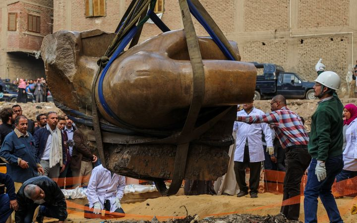 The torso being unearthed in Cairo.