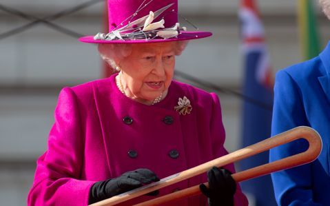 The Queen inspects the Gold Coast baton.