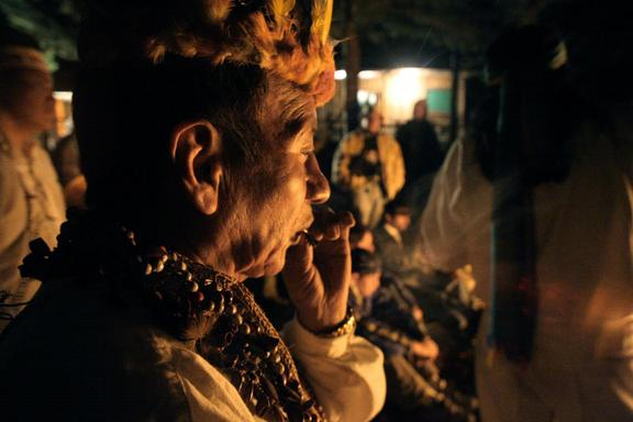 A man smokes 'sacred tobacco' at the start of an ayahuasca ritual ceremony, in Ecuador.