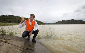 Watercare's Joseph Chaloner Warman with a water sample in the Hunua Ranges.