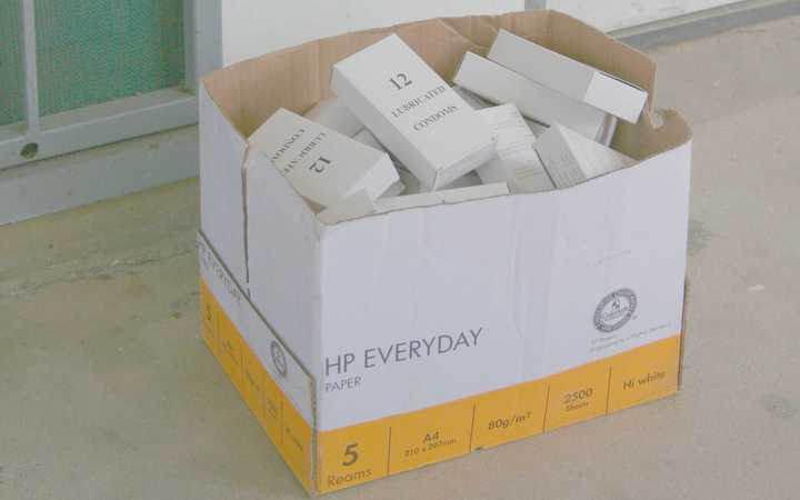 Box of condoms laying idle at Port Moresby General Hospital, Papua New Guinea.
