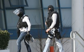 Armed French policemen wearing bulletproof jacket walk at the Tocqueville high school in the southern French town of Grasse, on March 16, 2017