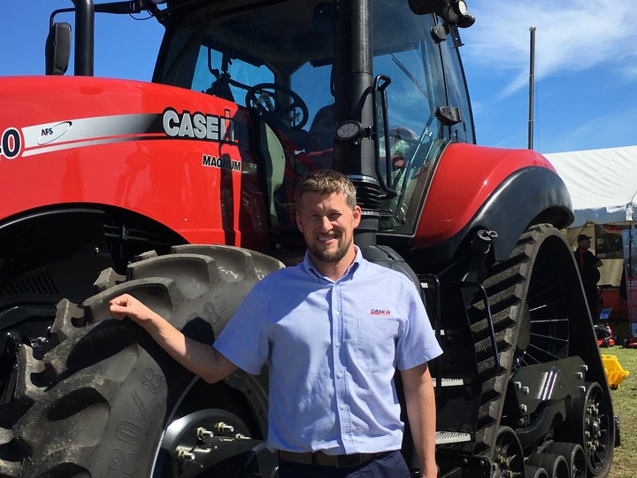 Case IH operations manager Tim Fanning infront of a Magnum Rowtrac.