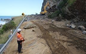 Workers clear the slip at Ohau Point north of Kaikōura.