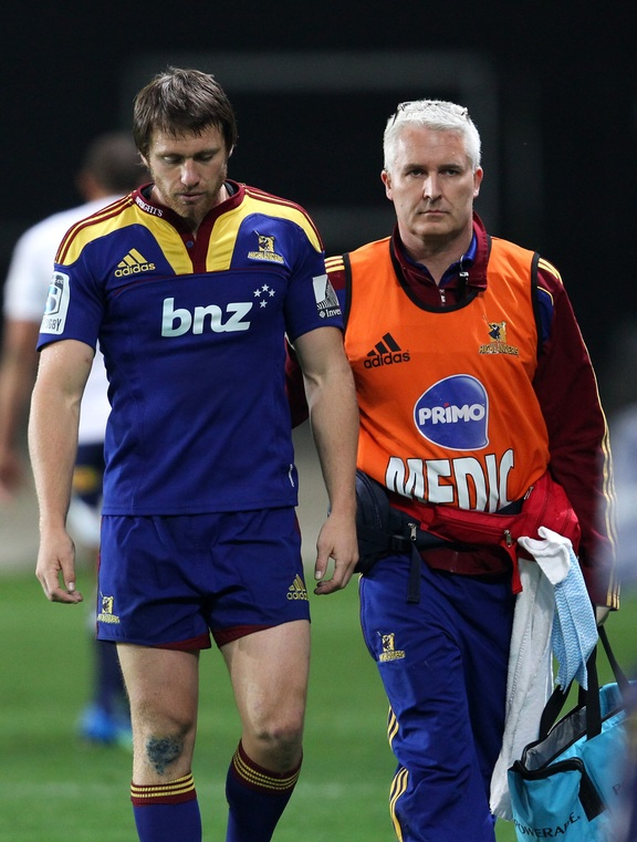 Ben Smith leaves the field after suffering a concussion during a Super Rugby match in April 2012.