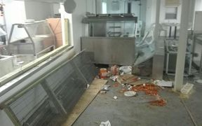 Destruction caused by the brawl in Mike Compound dining area.