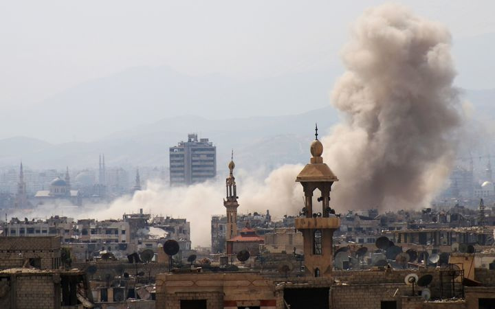 Smoke billows following a reported air strike in the rebel-held parts of the Jobar district, on the eastern outskirts of the Syrian capital Damascus.