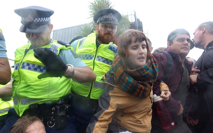 Police try to move on protesters outside the NZ Petroleum Conference in New Plymouth.