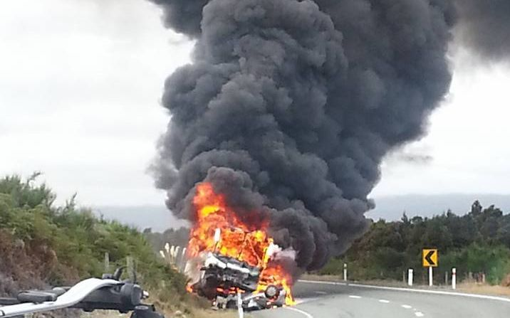 The crashed vehicles were engulfed in flames after the crash.