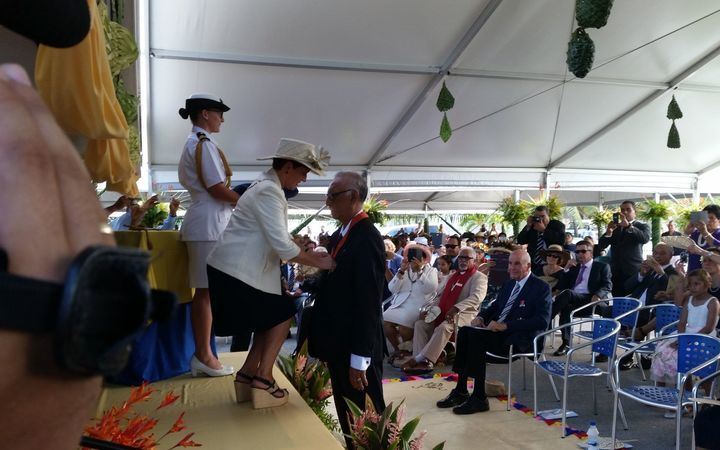 Niue's Premier Toke Talagi receiving his knighthood from from New Zealand's Governor General Patsy Reddy.