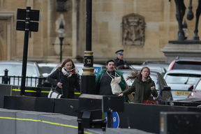 People run from the scene outside the Houses of Parliament.