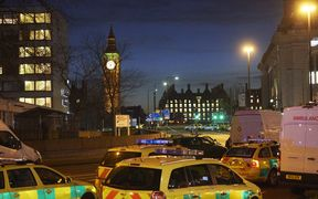 Emergency services in the area around the attack as night falls in London.