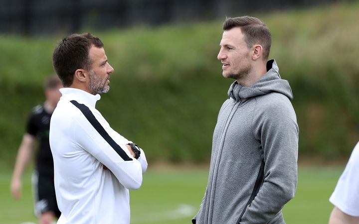 Anthony Hudson and Tommy Smith talk at All Whites training.